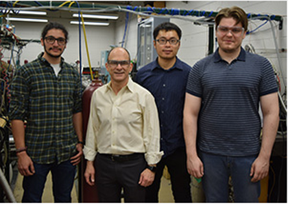 Professor Brezinsky with students at lab