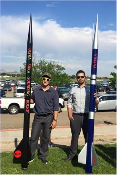 Students holding rocket entries