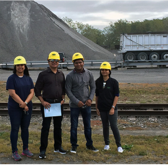 Professor Reddy with students at landfill