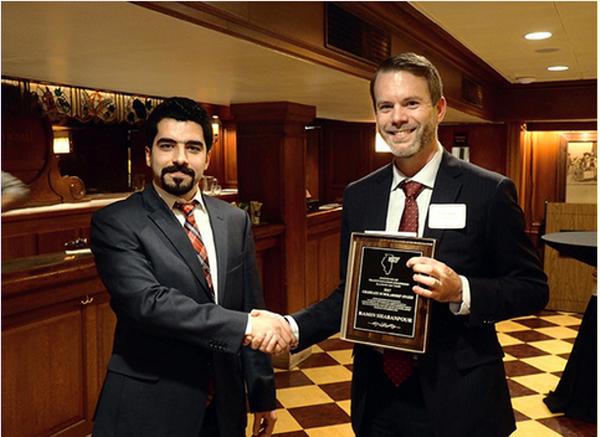 Ramin Shabanpour receives award plaque
