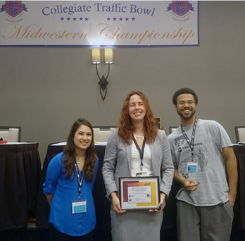 Diana Briones, Austin Bernat, and Natalia Kuvakina accept certificate