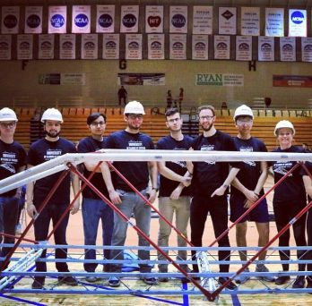 ASCE students with steel bridge construct