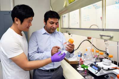 Professor Anand and assistant doing experiment