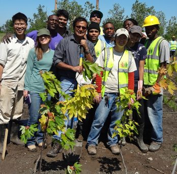 Professor Reddy planting trees with students