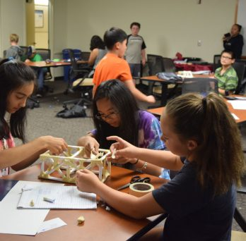 Young students building a rectangular structure