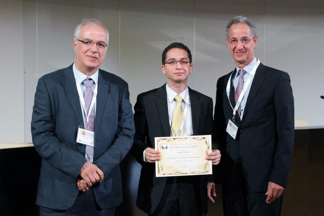 Professor Soltanalian holding award certificate
