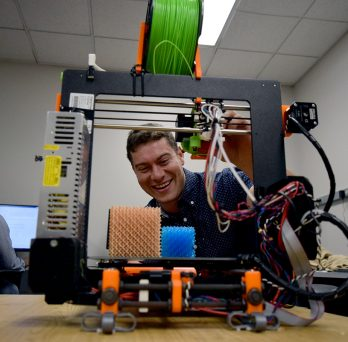 John Klein using a 3D printer