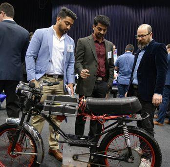 Viewers Admire Bike Design