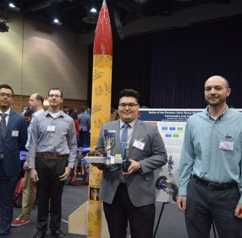 Students display rocket and rover