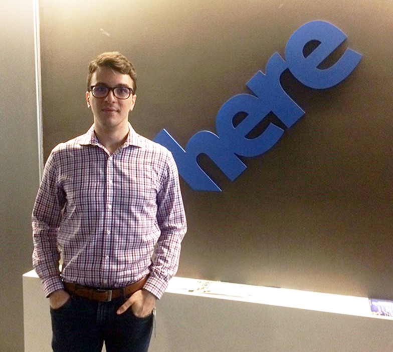 Alex Iacobucci in front of Here logo