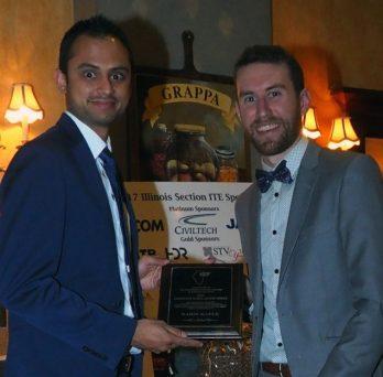 Nima Golshani and Nabin Kafle receive award plaque