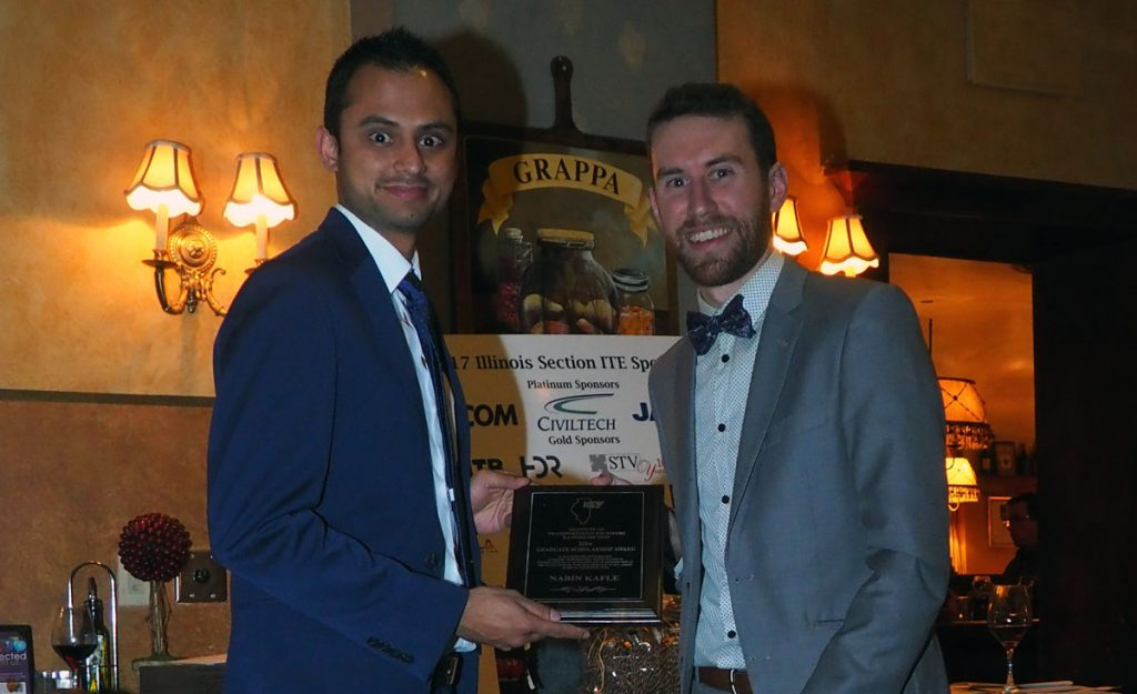 Nima Golshani and Nabin Kafle receive award plaque