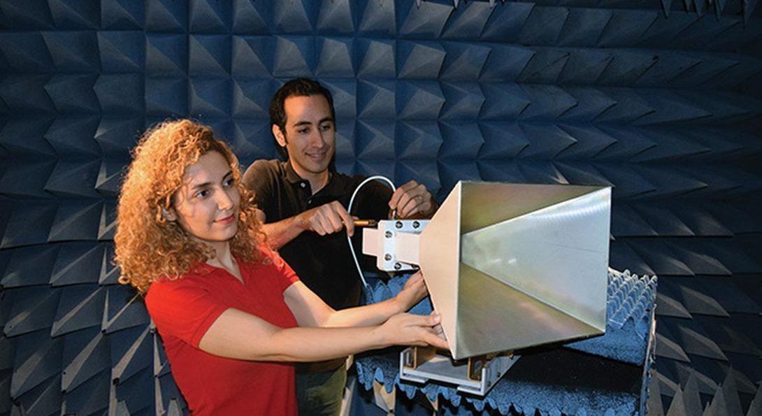 Seiran Khaledian and Farhad Farzami adjust an amplifier