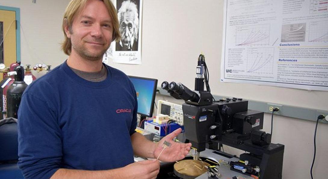 Professor Paprotny holding air quality sensor