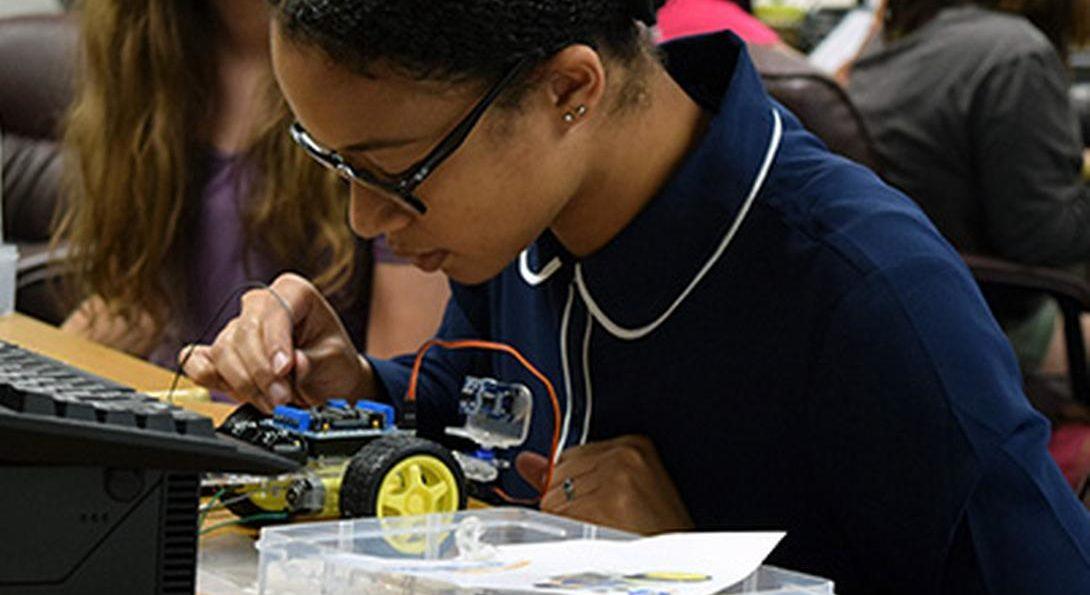 Student building a model car
