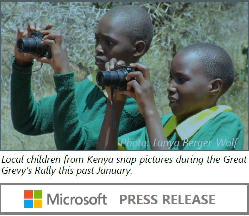 Kenyan children using cameras