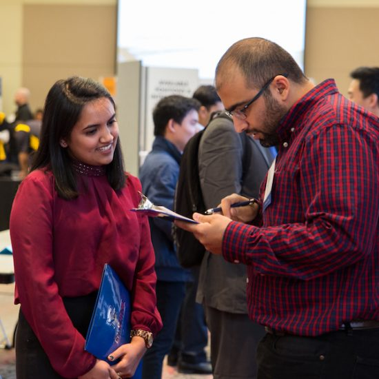 student talking to employer at career fair