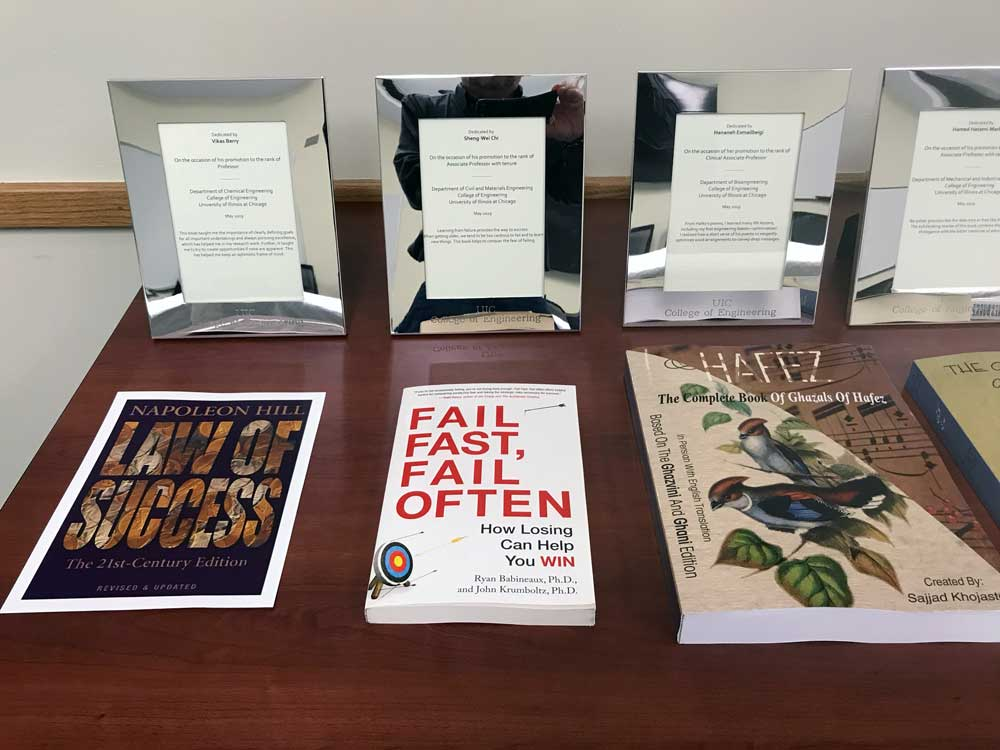 faculty books laid out on a table