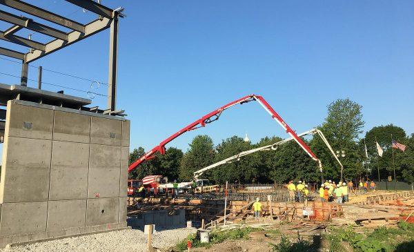 concrete trucks pouring foundation