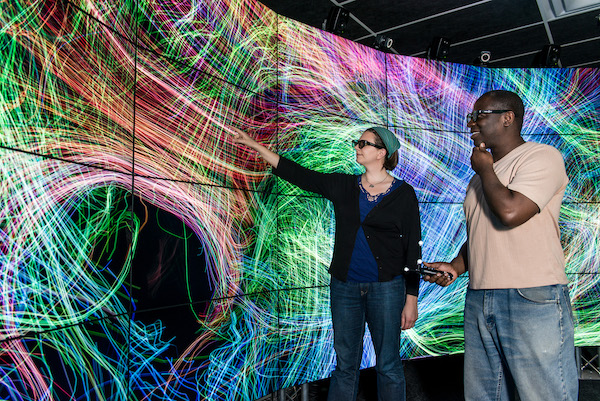 two people in UIC's Electronic Visualization Lab