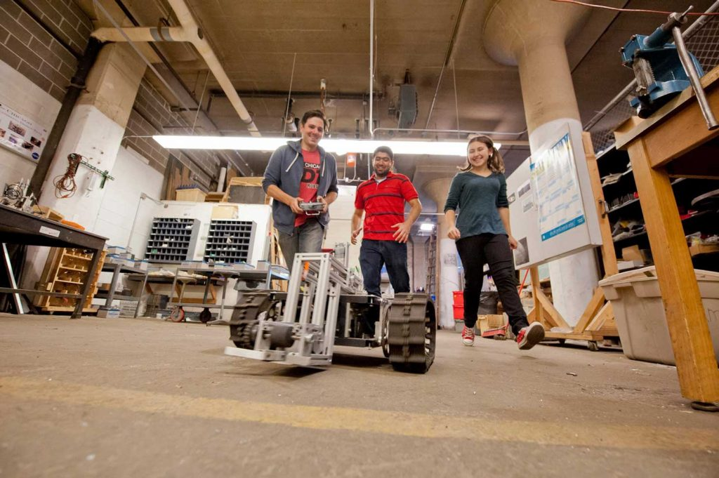 students with a robotics-based Expo project