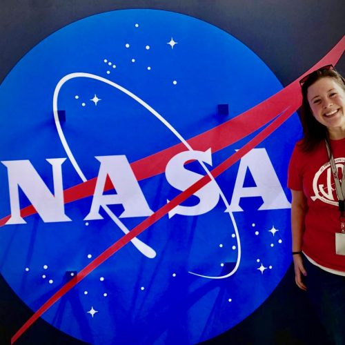 student posing with NASA logo