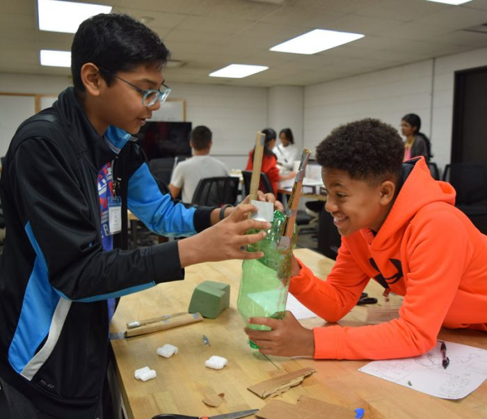 camp participants working together on a project