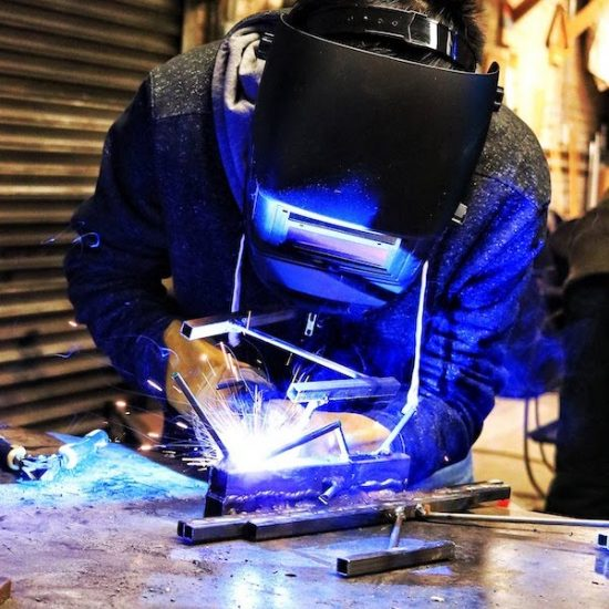 Student welding in the MakerSpace