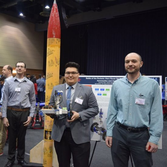 students with Expo rocket project