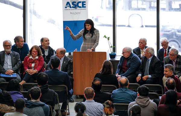 Alumna Michelle Calcagno speaking from a podium at the ASCE Legends event