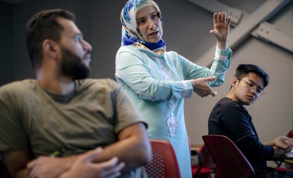 Betul Bilgin, chemical engineering faculty member, teaches small groups in class
