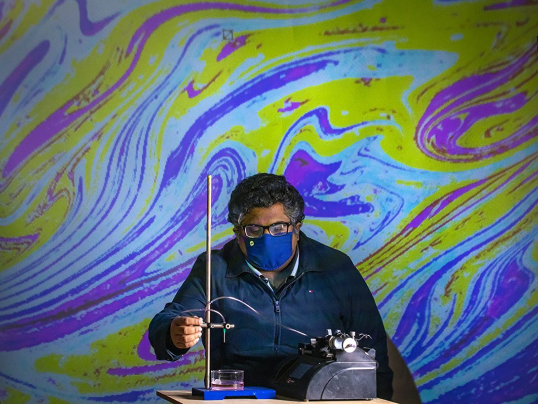 Varun Kulkarni, a post-doc researcher, investigating oil droplets in water